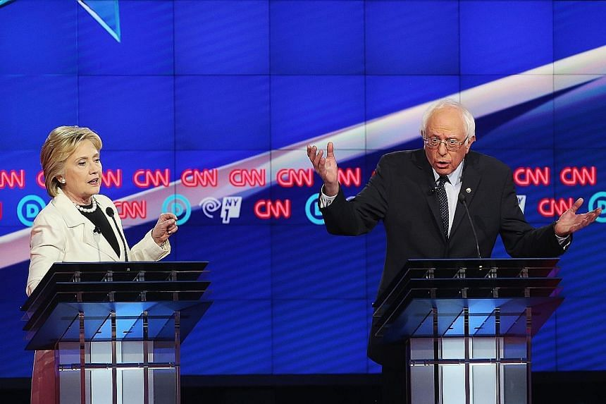 Mrs Clinton and Mr Sanders squaring off in Brooklyn on Thursday. The two rivals for the Democratic Party's nomination for the US presidency hit each other hard on a broad range of issues in an ill-tempered affair that had them interrupting each other