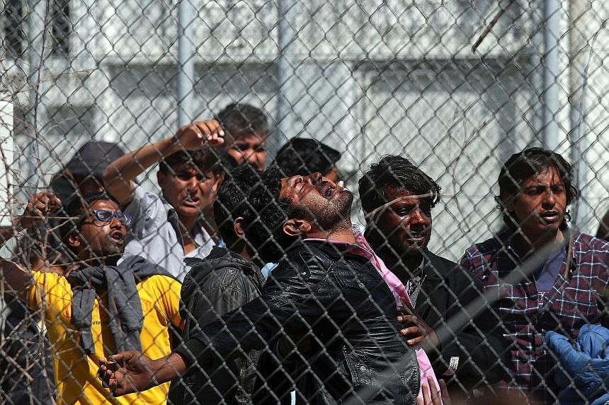 Migrants protesting against deportations in the refugee camp Moria on Lesbos island in Greece on April 5. The camp is a sprawling, fenced complex holding more than 3,000 refugees.