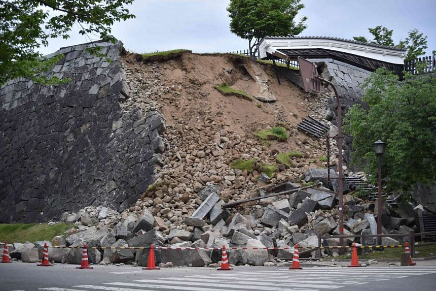 A collapsed stone wall of the Kumamoto Castle in Kyodo on April 15, 2016.