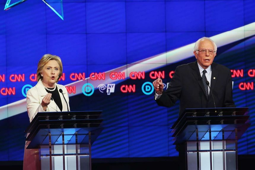 Democratic Presidential candidates Hillary Clinton and Senator Bernie Sanders debating during the CNN Democratic Presidential Primary Debate at the Duggal Greenhouse in the Brooklyn Navy Yard on April 14, 2016, in New York City.