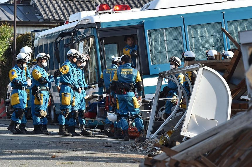 Policemen preparing to start a rescue mission in Mashiki, Kumamoto prefecture on April 16, 2016.