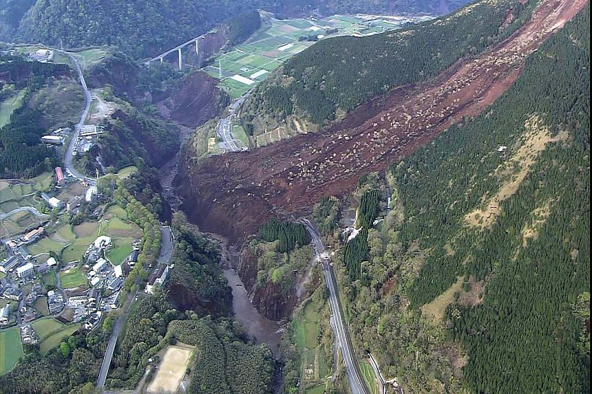 This handout photo taken and released by Japan's Defence Ministry via Jiji Press on April 16, 2016, shows an aerial view of a landslide in Mimami-Aso, Kumamoto prefecture.