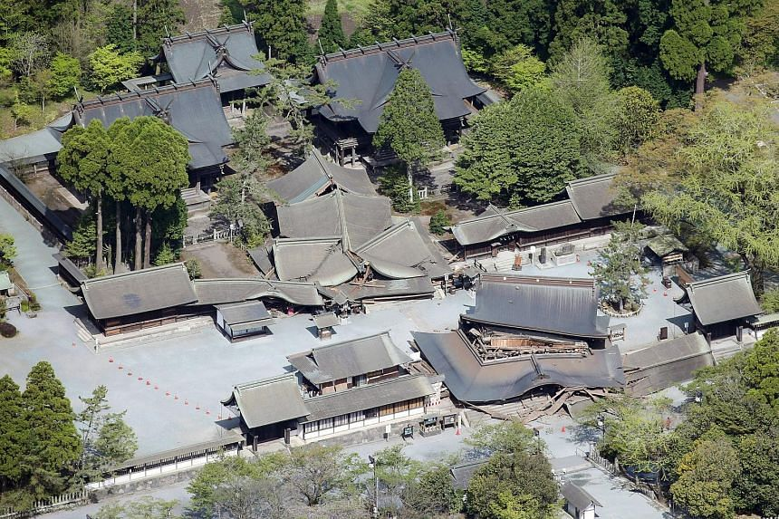Romon gate (bottom right), designated as a nationally important cultural property, and other buildings damaged by an earthquake are seen at Aso Shrine in Aso, Kumamoto prefecture, southern Japan, in this photo taken by Kyodo on April 16, 2016.