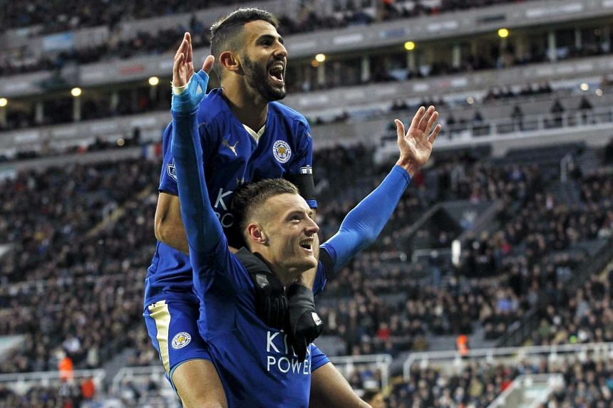 Jamie Vardy celebrating with Riyad Mahrez after scoring the first goal for Leicester City during their English Premier League soccer match against Newcastle United at St James' Park in Newcastle, Britain, in this on Nov 21, 2015 file photo.
