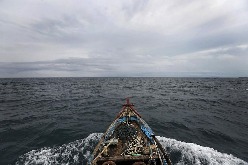 A boat heading towards fishing grounds off the east coast of Natuna Besar.