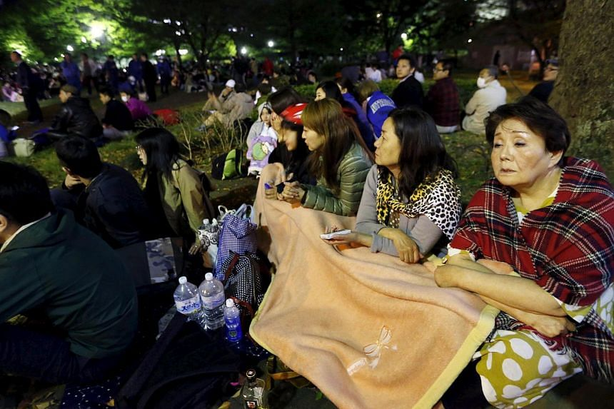 Evacuated residents gathering at Shirakawa park after an earthquake in Kumamoto, southern Japan, in this photo taken by Kyodo, on April 16, 2016.