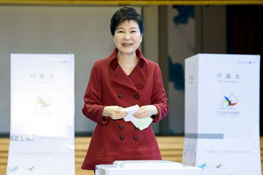 South Korean President Park Geun Hye casting her ballot at a polling station in Seoul, in this handout picture provided by the Presidential Blue House and released by News1 on April 13, 2016.