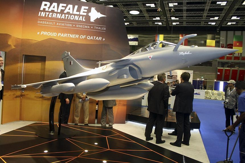 A model of Dassault Rafale fighter jet is seen during Doha International Maritime Defence Exhibition, Qatar on March 31, 2016.