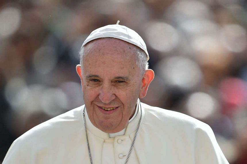 Pope Francis greeting the crowd as he arrives for his weekly general audience at St Peter's square on April 13, 2016 at the Vatican.