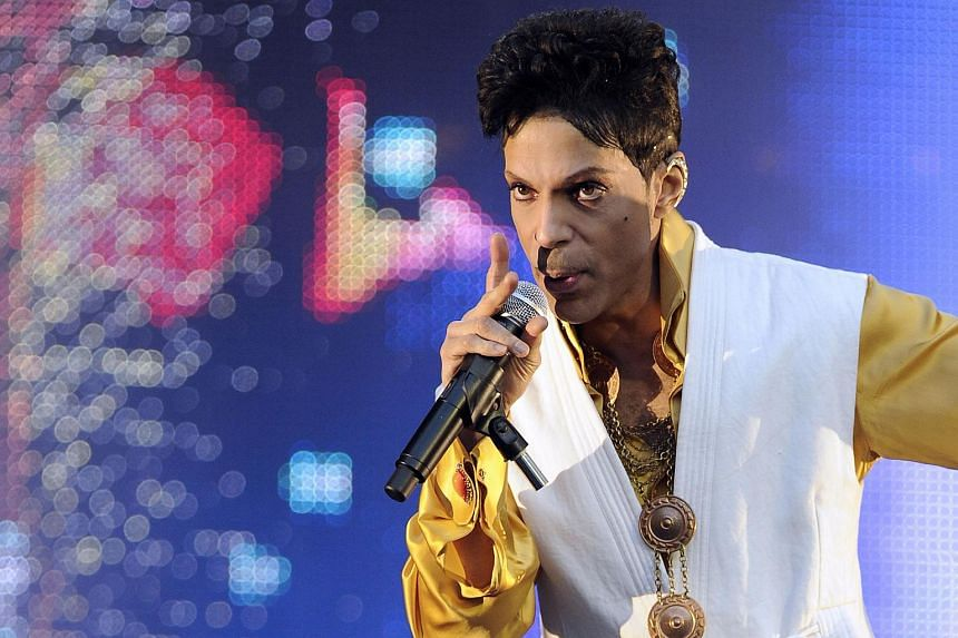 US singer and musician Prince performing on stage at the Stade de France in Saint-Denis, outside Paris, on June 30, 2011.