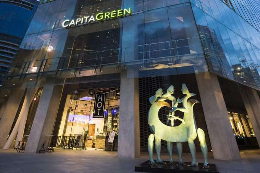 CapitaLand Commercial Trust has a 40 per cent interest in CapitaGreen (above), a commercial building in the Central Business District, and a 60 per cent interest in Raffles City Singapore.