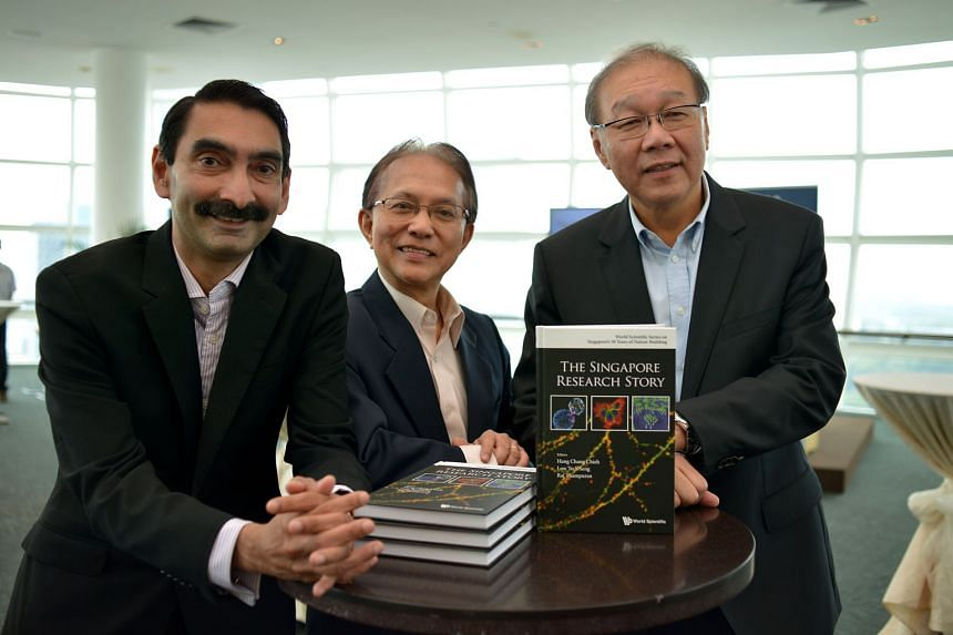 At the launch of the book are (from left) Agency for Science, Technology and Research managing director Raj Thampuran, NUS' Prof Hang and NRF's chief, Prof Low.