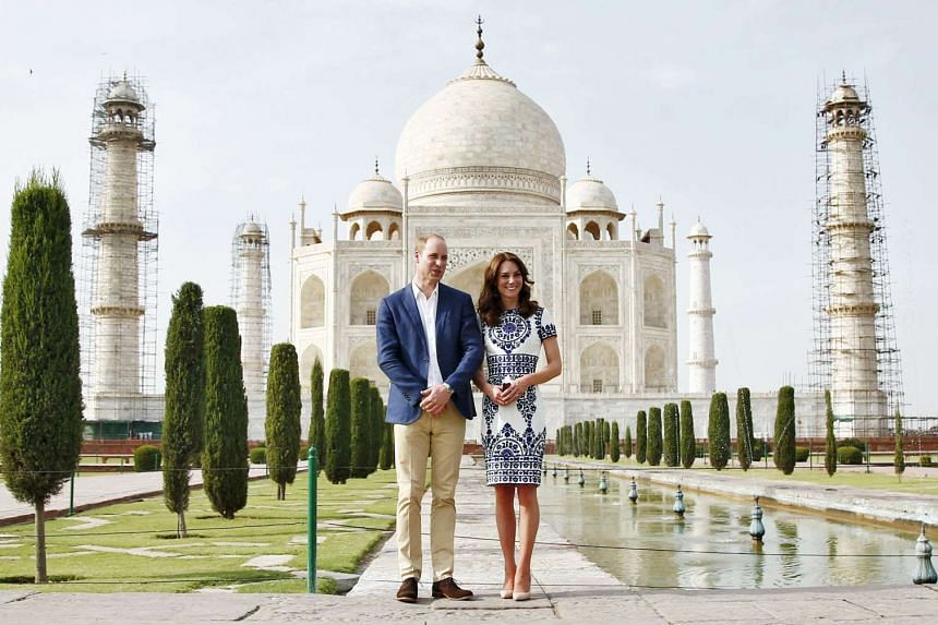 Britain's Prince William and his wife Catherine, the Duchess of Cambridge, pose at the Taj Mahal in Agra, India, on April 16, 2016.