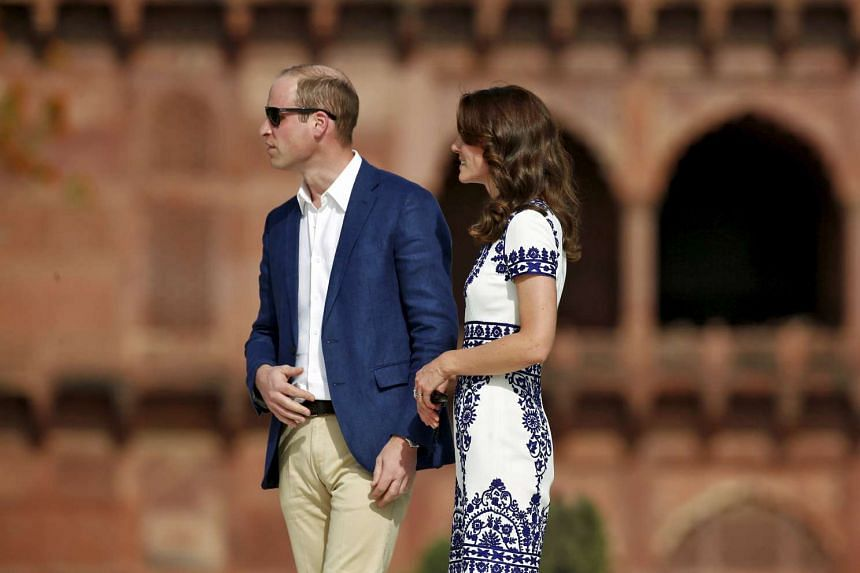 Britain's Prince William and his wife Catherine, the Duchess of Cambridge, visit the Taj Mahal in Agra, India, on April 16, 2016.