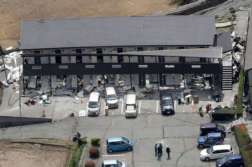 The aerial view shows damaged apartments after an earthquake in Minami-Aso, Kumamoto prefecture on April 16, 2016.