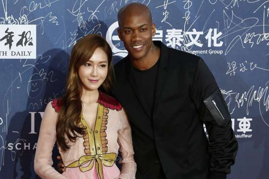 Korean-American singer Jessica Jung (left) and basketball player Stephon Marbury arrive for the opening ceremony of the 6th Beijing International Film Festiva on April 16, 2016.
