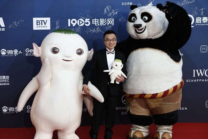 Hong Kong actor and animator Raman Hui (centre) and characters from Monster Hunt and Kung Fu Panda arrive for the opening ceremony of the 6th Beijing International Film Festiva on April 16, 2016.