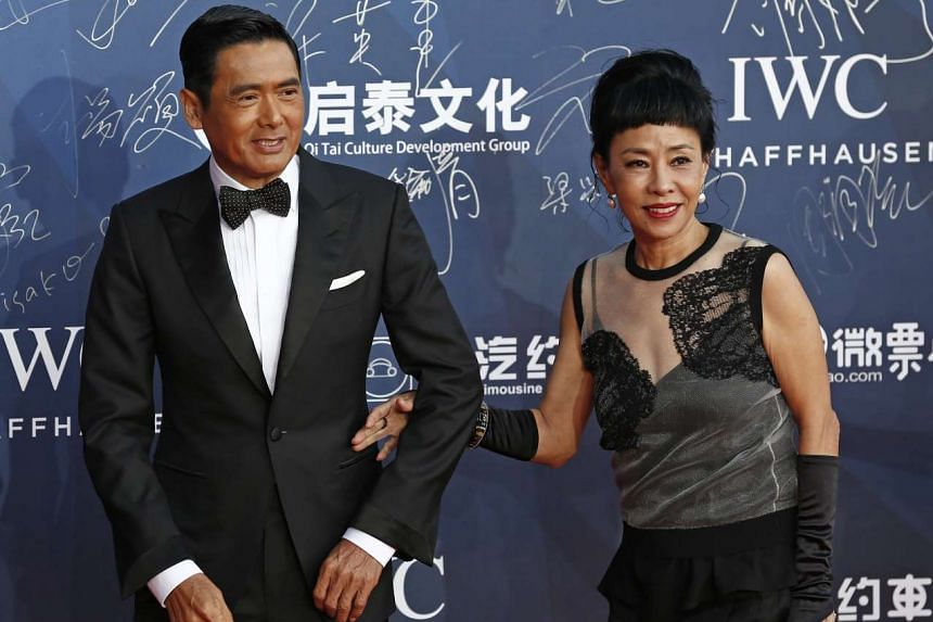 Chinese actor Chow Yun-Fat (left) and his wife Jasmine arrive during the opening ceremony red carpet event of the 6th Beijing International Film Festival in Beijing, China on April 16, 2016.