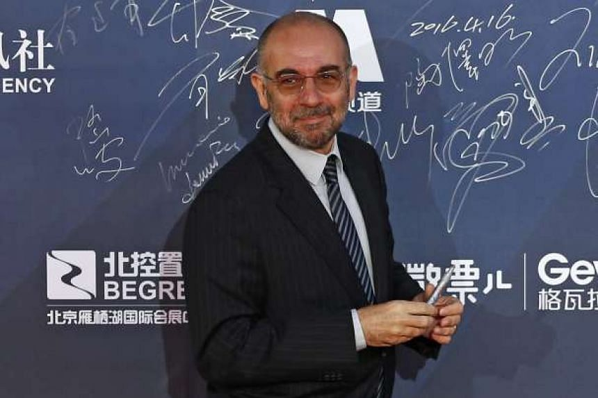 Italian film-maker Giuseppe Tornatore arrives during the opening ceremony red carpet event of the 6th Beijing International Film Festival in Beijing, China on April 16, 2016.