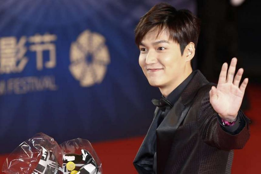 South Korean actor Lee Min Ho arrives during the opening ceremony red carpet event of the 6th Beijing International Film Festival in Beijing, China on April 16, 2016.