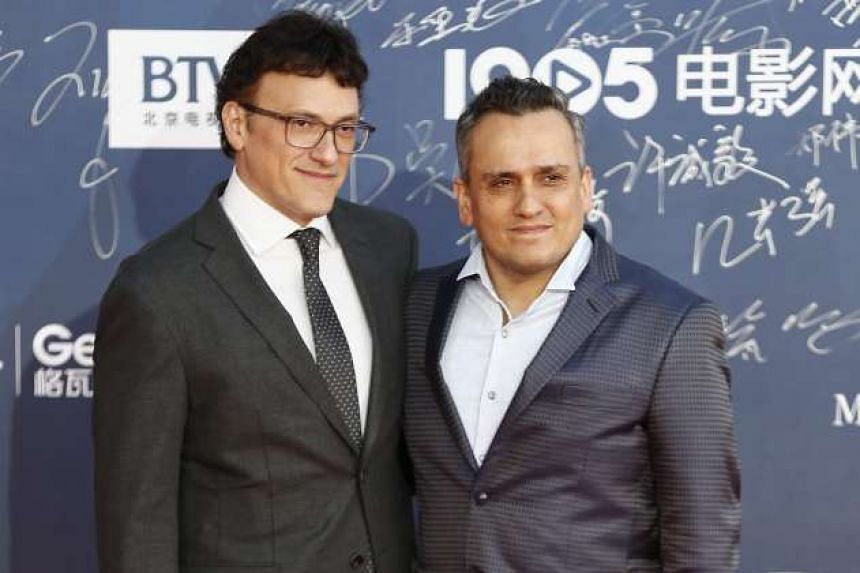 American directors Anthony Russo (left) and Joe Russo arrive during the opening ceremony red carpet event of the 6th Beijing International Film Festival in Beijing, China on April 16, 2016.