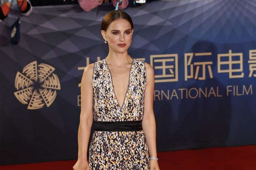 American actress Natalie Portman arrives for the opening ceremony red carpet event of the 6th Beijing International Film Festival in Beijing, China on April 16, 2016.