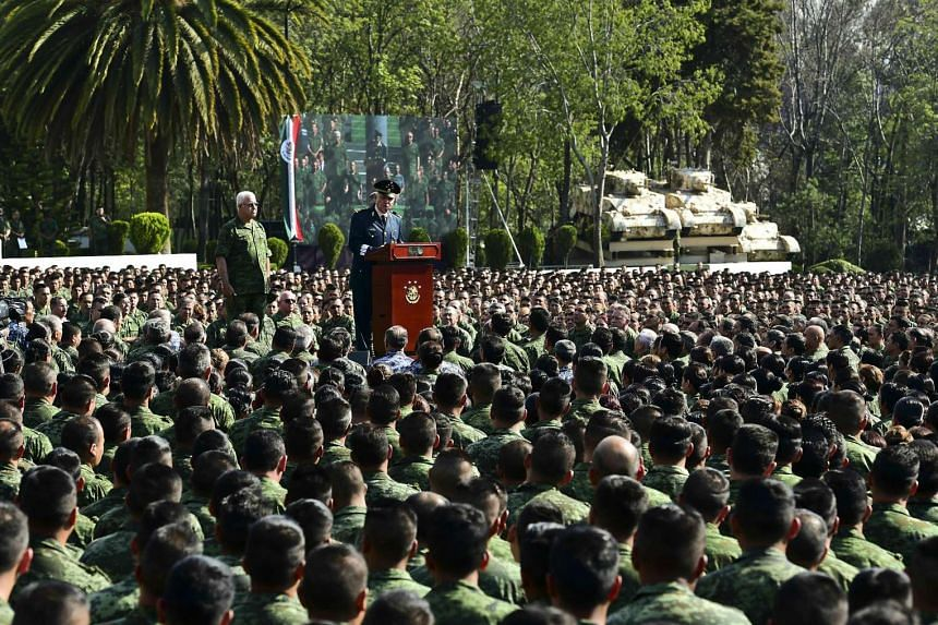 Mexican Defense Secretary Salvador Cienfuegos reads out a public apology before 26,000 soldiers assembled at a military base in Mexico City on April 16, 2016.