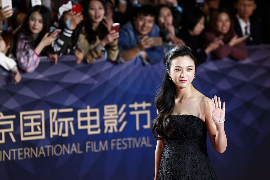 Chinese actress Tang Wei arrives for the opening ceremony red carpet event of the 6th Beijing International Film Festival in Beijing, China on April 16, 2016.