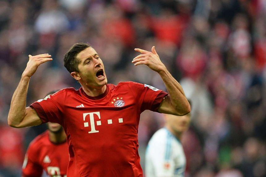 Bayern Munich's Robert Lewandowski celebrates after scoring the 1-0 lead during the German Bundesliga soccer match between FC Bayern Munich and FC Schalke 04 in Munich, Germany, on April 16, 2016.