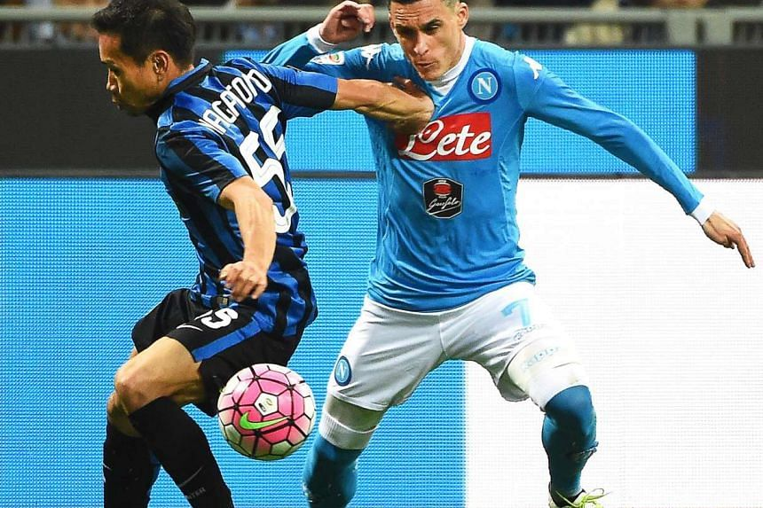 Inter's Yuto Nagatomo (left) in action against Napoli's Jose Callejon (right) during the Italian Serie A soccer match between Inter Milan and SSC Napoli at Giuseppe Meazza stadium in Milan, Italy, on April 16, 2016.