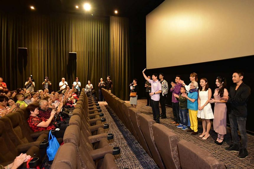 Mr Chee Hong Tat (waving to crowd), with the cast of Long Long Time Ago 2 at a movie screening for 180 elderly members of the Bishan-Toa Payoh constituency on April 17, 2016.
