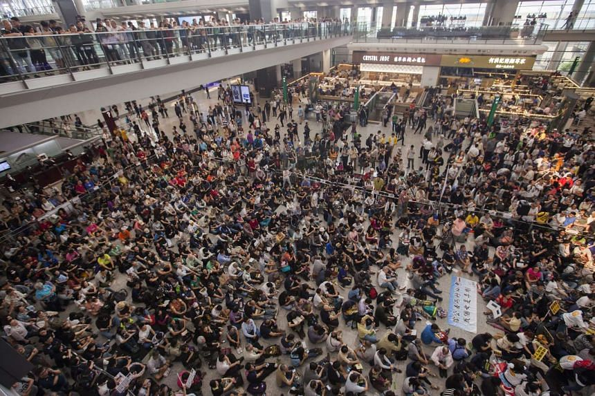 Hundreds of protesters during a sit-in at Hong Kong International Airport on April 17, 2016.