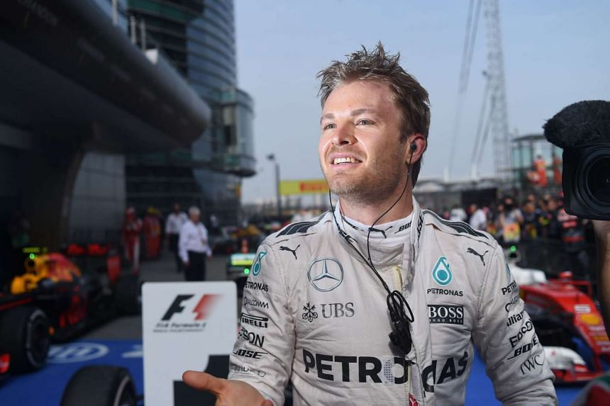 Nico Rosberg poses for photos after winning the Formula One Chinese Grand Prix in Shanghai on April 17, 2016.