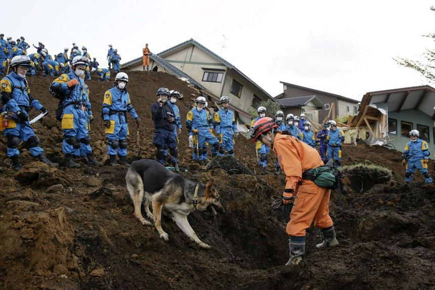 Rescue workers take part in a massive rescue operation searching for missing residents in Minamiaso, Kumamoto Prefecture, Japan on April 17, 2016.