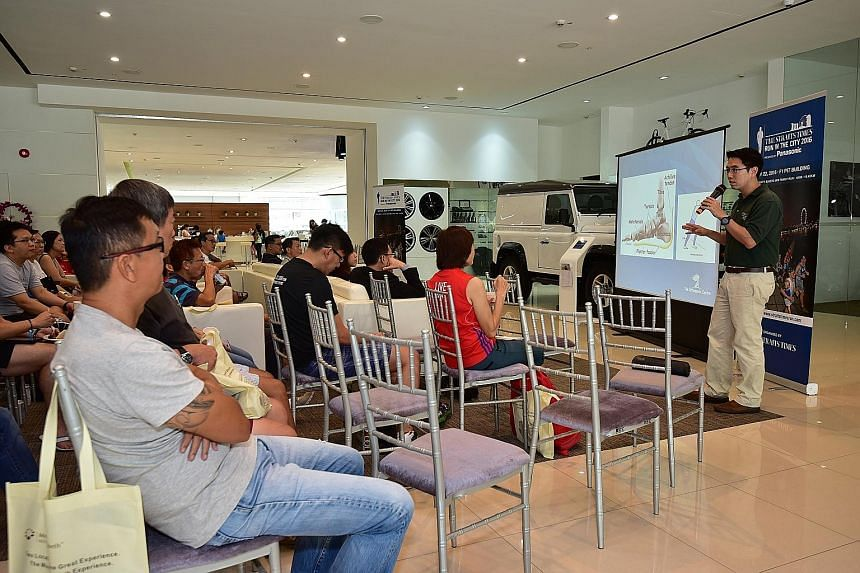 Dr Su speaking about common foot injuries and how to prevent and treat them, at the second ST Running Clinic held yesterday at the Land Rover showroom.