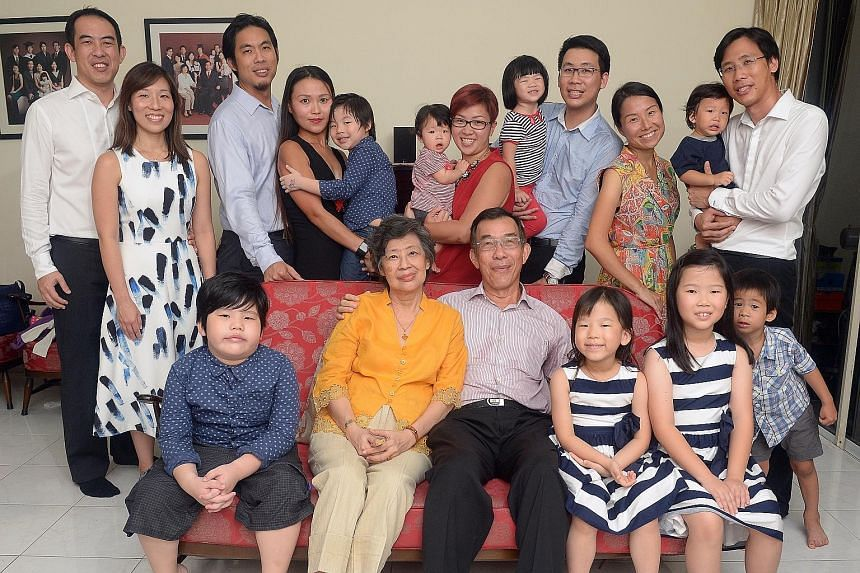 Mr David Choo (front row) with his wife Florence Tan and their grandchildren. (Back row from left) Eldest son Jonathan and wife Marianne; second son Wesley and wife Kareen; and twin sons Daniel and Graham (far right) with their respective wives Faith