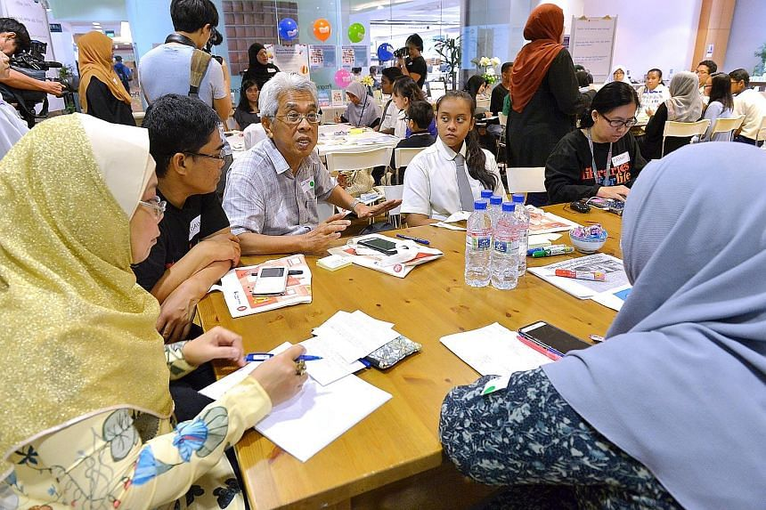 Former Muis president Maarof Salleh (centre) addressing other participants at the SGFuture engagement session at Bedok Public Library yesterday.