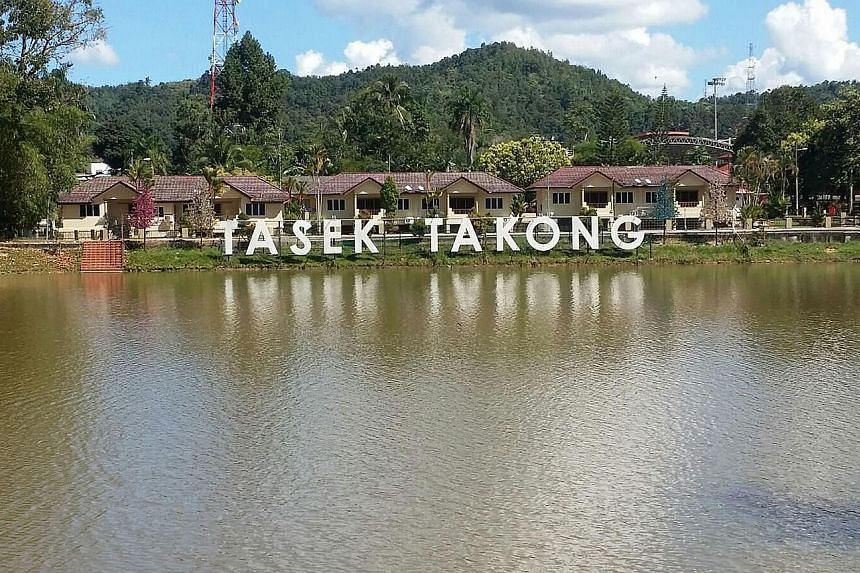 Man-made lake Tasek Takong, which is located near the Perak-Thai border, used to be popular with anglers and picnickers (left), but the lake has disappeared as the water has dried up during the prolonged hot and dry spell (right). The lake last dried
