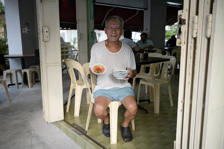 """Stall supervisor Cher Kee Chiang of Ah Chiang Porridge in Tiong Poh Road says his stall got the approval to sell ready-to-eat raw salmon in January but business has plummeted. """"People don't really like the Norwegian salmon we sell, because it is too"""