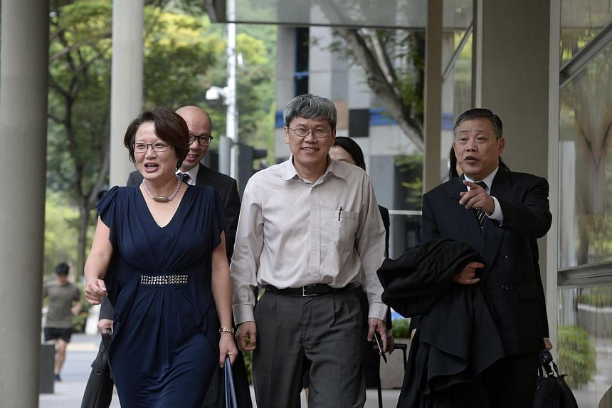 Workers' Party MPs Sylvia Lim and Png Eng Huat (centre) with lawyer Peter Low, who is representing the Workers' Party-run Aljunied- Hougang Town Council (AHTC), arriving at the Supreme Court on Jan 22, 2016.