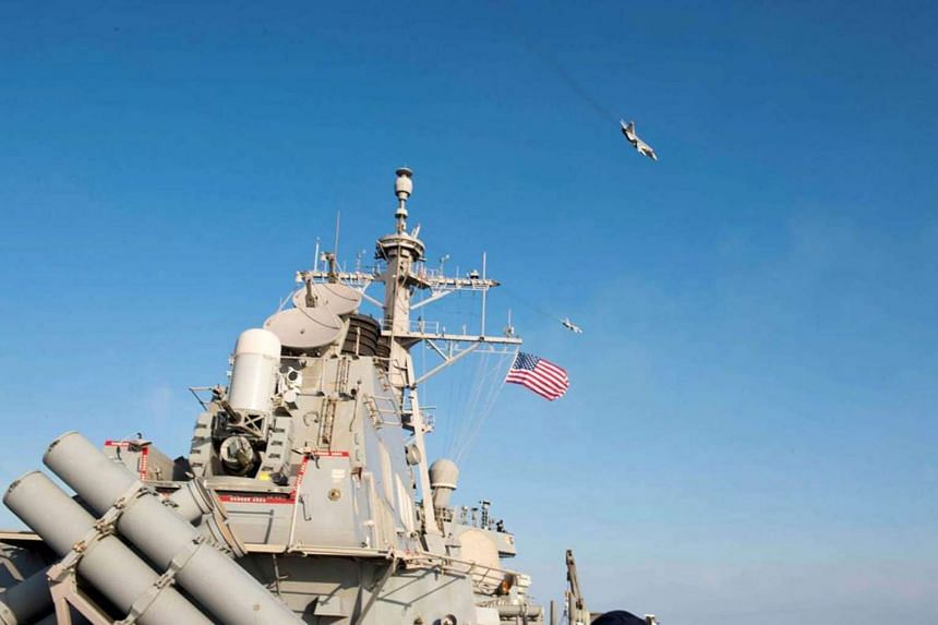 Two Russian Sukhoi Su-24 attack aircraft fly over the USS Donald Cook (DDG 75) in the Baltic Sea, on April 12, 2016.