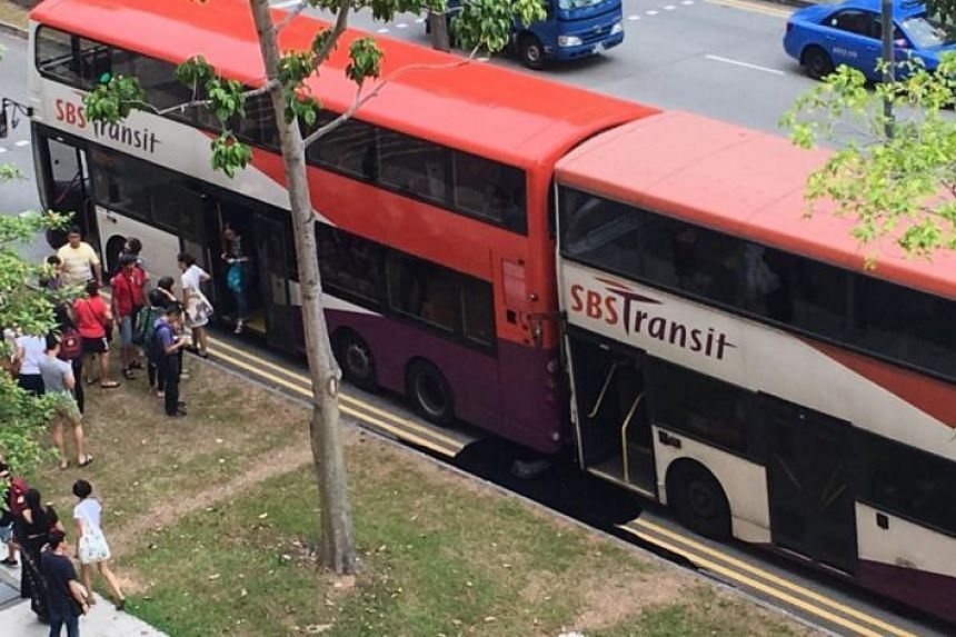 Passengers alighting from the bus after a collision between SBS Transit services 109 and 81.