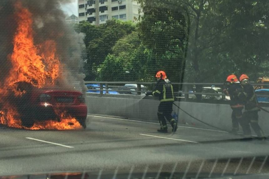 SCDF personnel putting out the car fire, which broke out on the CTE near the Balestier Road exit.