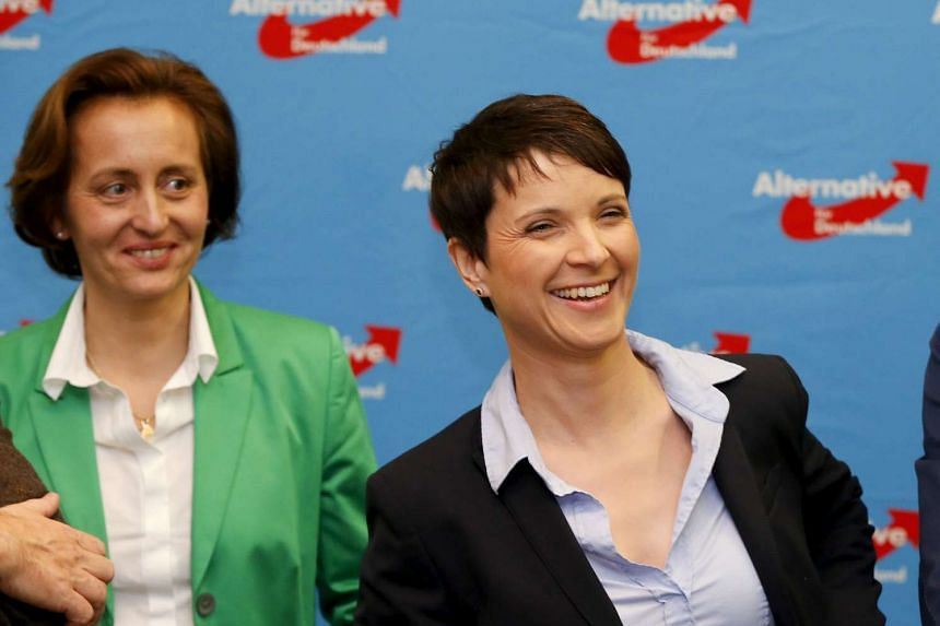 Ms Beatrix von Storch (left) of the anti-immigration party Alternative for Germany (AfD) looks on as party chairman Frauke Petry speaks in Berlin.