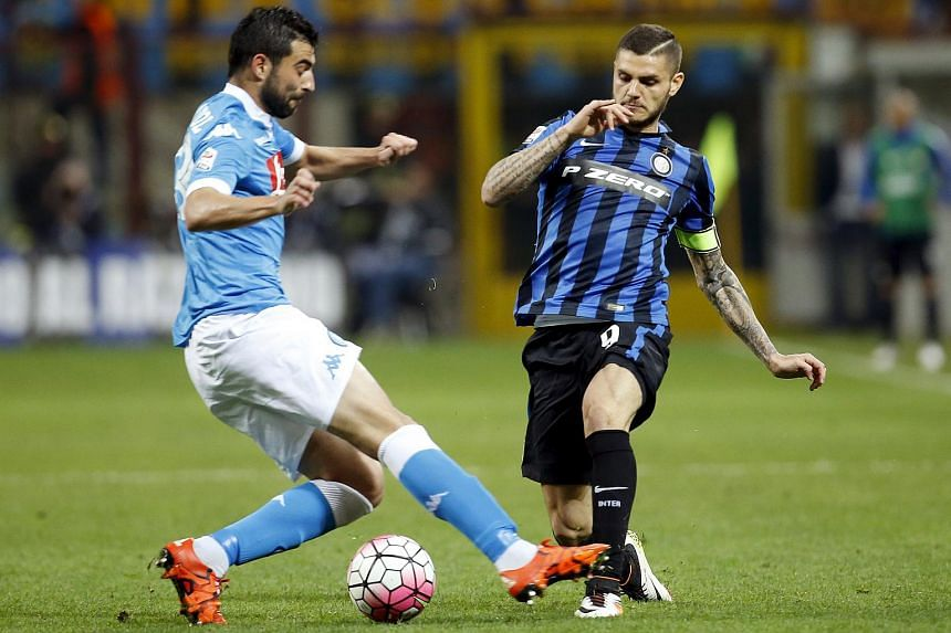 Inter Milan' Mauro Icardi (right) in action against Raul Albiol of Napoli.