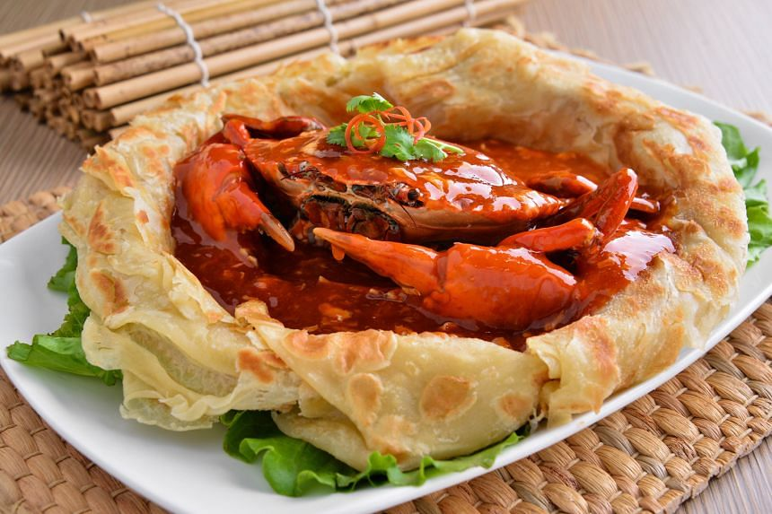 "Signature chilli crab in a ""prata bag"" (seasonal price,$80 to $128 for 1kg)"