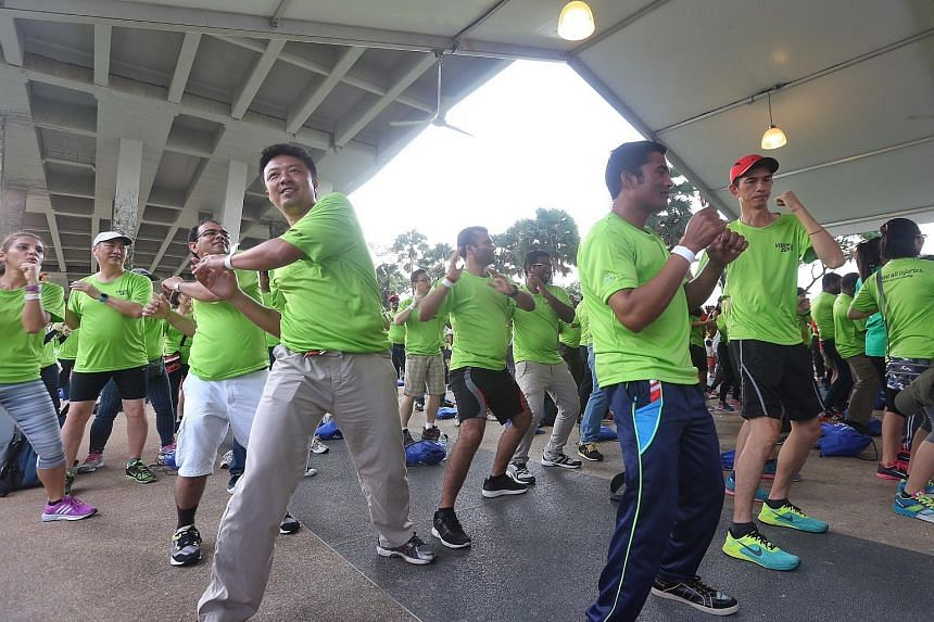 Vision Zero walk participants take part in a warm-up Zumba session before the event.