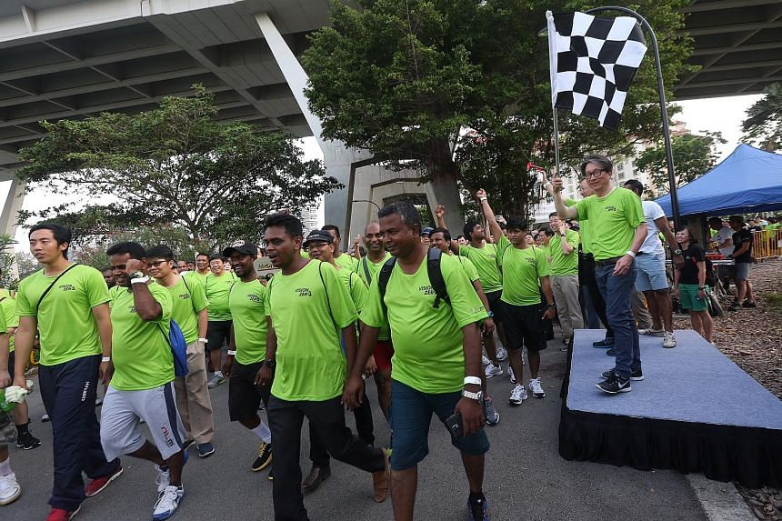 Mr Lim (extreme right) flags off the walk.