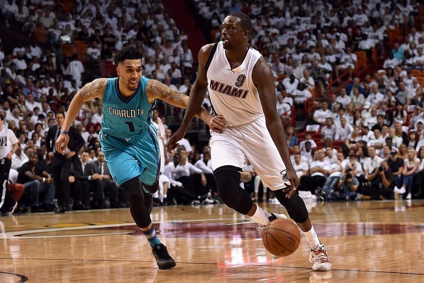Miami Heat forward Luol Deng (right) attacking the paint against Charlotte Hornets guard Courtney Lee during their first-round NBA playoff game on April 17, 2016.