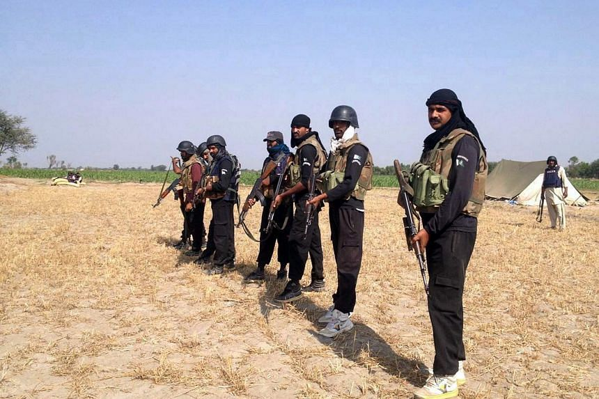 Pakistani policemen preparing to take part in an operation against alleged criminals in Rajanpur district in southern Punjab province, on April 14, 2016.
